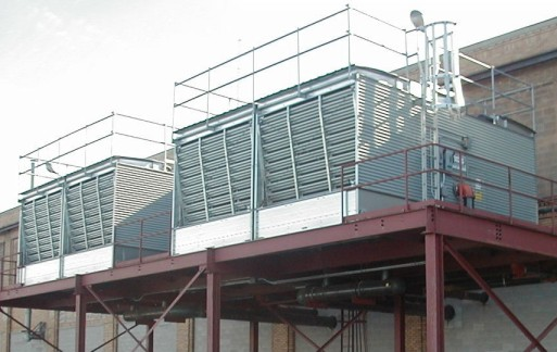 Steel galvanized cooling tower system installed on mezzanine at a petrochemical plant.