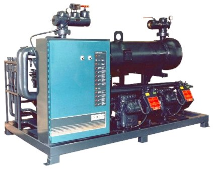 Air cooled indoor remote chiller with shell and tube heat exchanger and dual compressors.