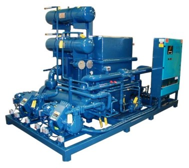 Indoor Skid Mounted Chiller Package with process tank, dual compressors, and control panel