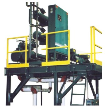 Indoor skid mounted remote industrial chiller on custom mezzanine with safety railing and ladder.