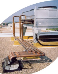 Roof mounted condenser with copper process piping