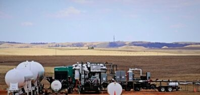 GTUIT System in operation in Bakken oil fields with tanker trucks for storage of natural gas liquids.